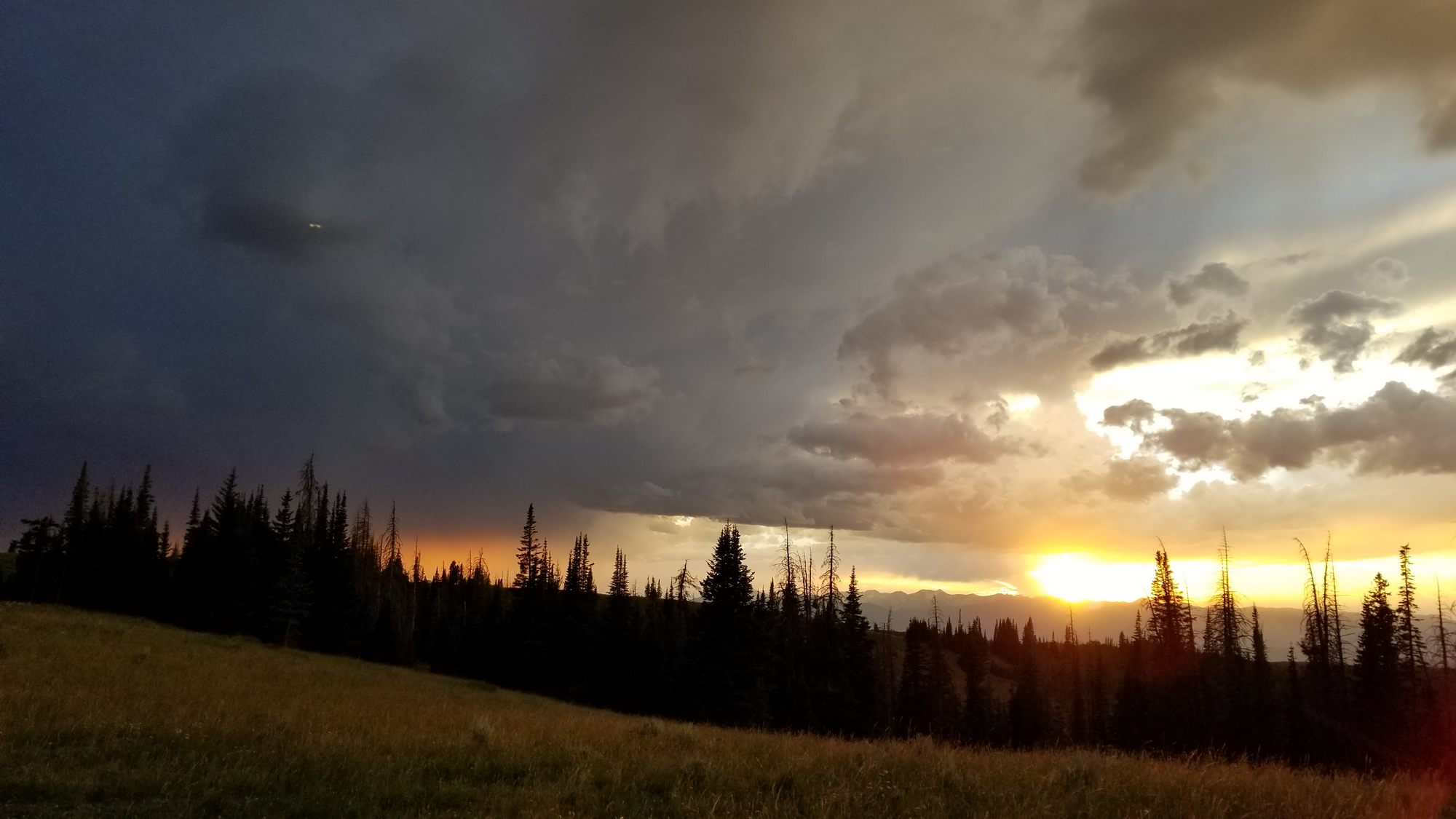 A sunset thunderstorm rolls into camp
